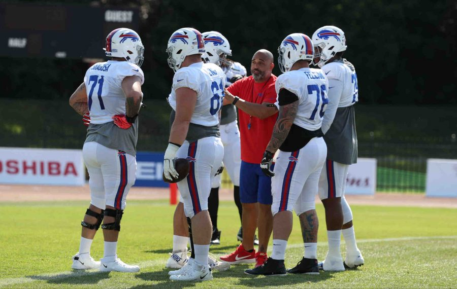 Bills offensive line coach Bobby Johnson coaches his players in a drill at training camp. (James P. McCoy/News file photo)