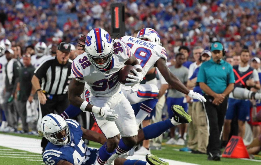 Bills running back Senorise Perry beats Colts linebacker E.J. Speed in the second quarter. (James P. McCoy/Buffalo News)