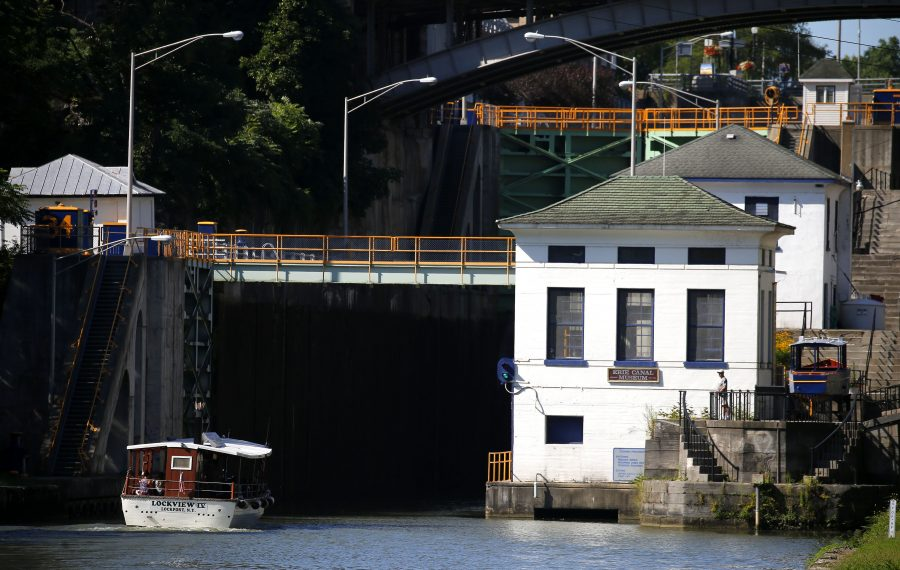 "The Lockview IV sails into the locks on the Erie Canal in Lockport. As the state looks to ""reimagine"" the canal, owners of the tour boat say a shortened season already has hurt business. (Mark Mulville/Buffalo News)"