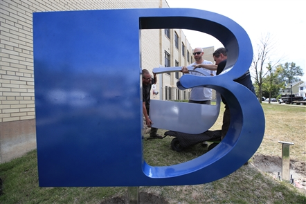 A new metal sign spelling out BUFFALO was installed Monday near the Cornelius Apartments at 1375 Hertel Ave. Andy Chambers of Arc Iron Creations fabricated the sign, which spells out BFLO or BUFFALO depending on the angle from which it is viewed.