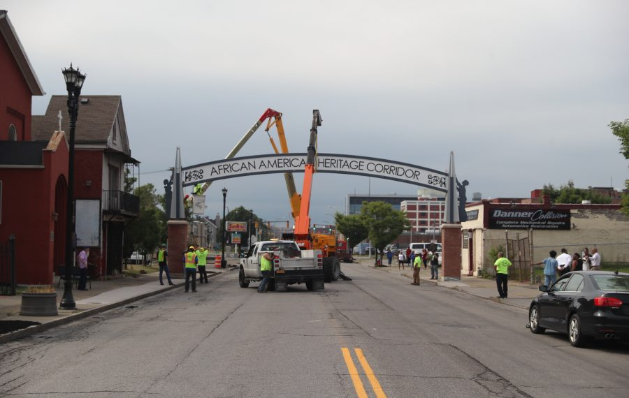 Workers install an arch across Michigan Avenue on Tuesday to mark Buffalo's Michigan Street African American Heritage Corridor. (John Hickey/Buffalo News)
