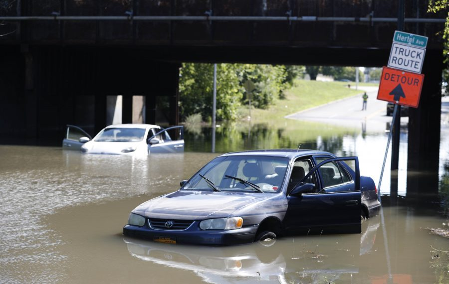 Two cars remain in deep water at an underpass on Kenmore Avenue at Ontario Street after getting stuck in the early morning hours Wednesday. (Sharon Cantillon/Buffalo News)
