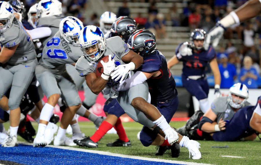 University at Buffalo running back Ron Cook, Jr. scores against Robert Morris during second half action at UB Stadium on Thursday, Aug. 29, 2019. (Harry Scull Jr./Buffalo News)