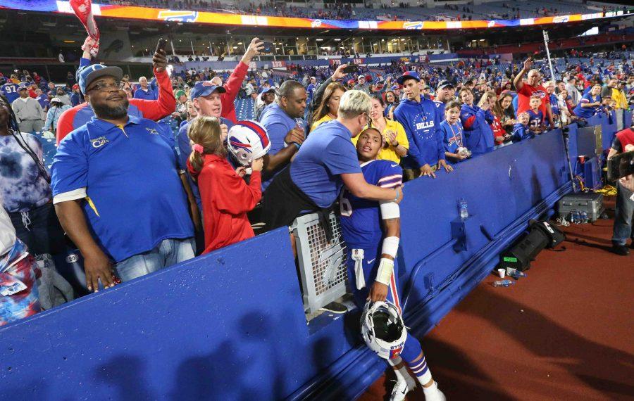 Buffalo Bills quarterback Tyree Jackson (6) receives a hug from his mom Susan Jackson after the Bills beat the Minnesota Vikings 27-23 in the preseason finale. (James P. McCoy/Buffalo News)