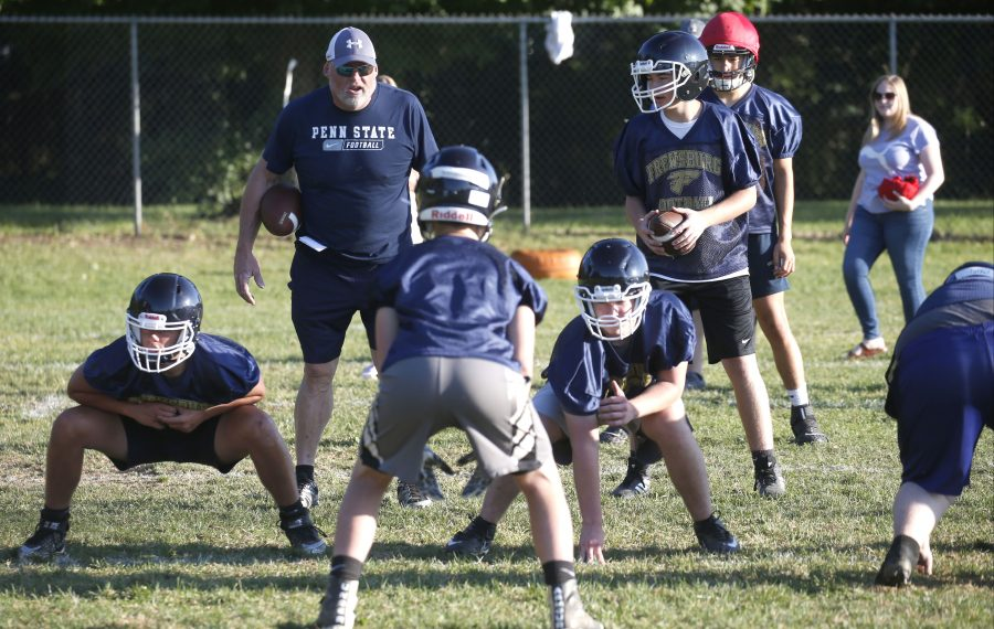 Frewsburg coach Terrance Gray shouts out plays with his new eight-man team. (Robert Kirkham/Buffalo News)
