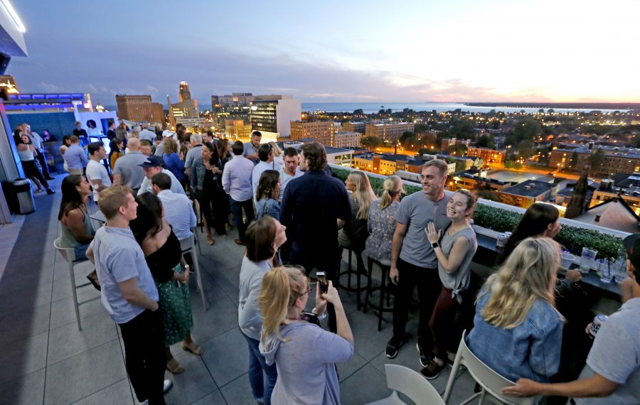 Patrons enjoy the amazing view on one of the patios at Patrick's Rooftop Bar on the 13th floor of 500 Pearl St.   (Robert Kirkham/Buffalo News)