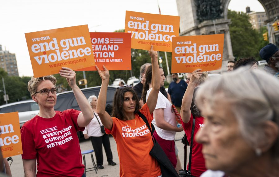People attend a vigil for the victims of the recent mass shootings in El Paso, Texas, and Dayton, Ohio, in Grand Army Plaza on Monday in Brooklyn. (Getty Images)