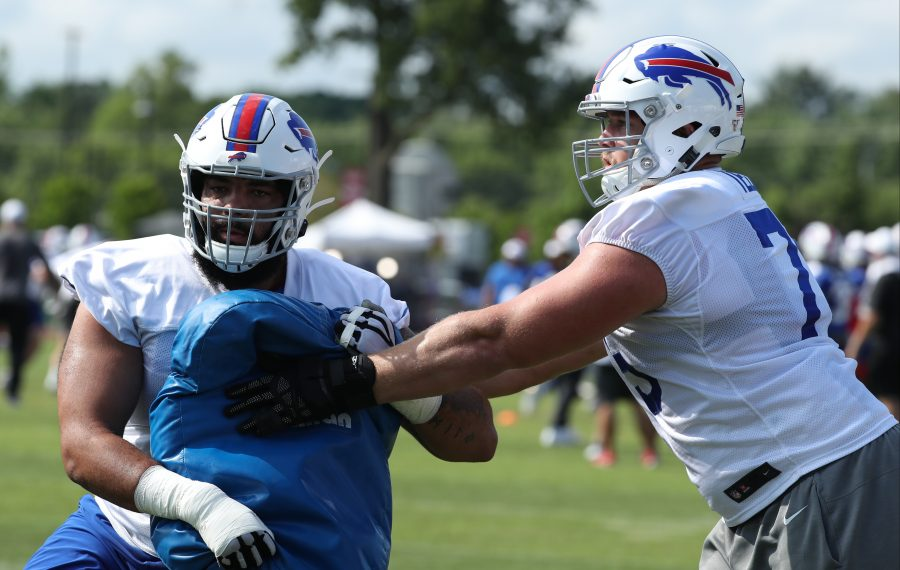 Bills offensive tackle Cody Ford (70) works on his blocking form with offensive guard Wyatt Teller (75) during practice Thursday at St. John Fisher College in Pittsford. (James P. McCoy/Buffalo News)