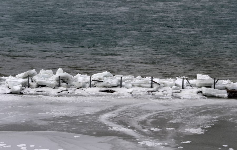 Ice covers the Bird Island Pier on Feb. 25, 2019, after a windstorm swept through. (John Hickey/News file photo)