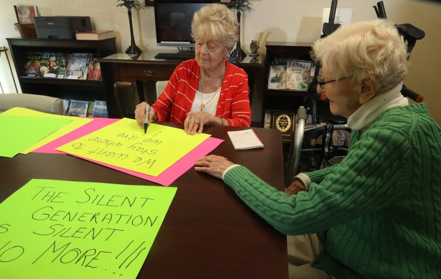 Blocher Homes residents Arlene H. Bolton, left, and Hilda Allen, make signs protesting the proposed closing of the assisted-living facility. Weather permitting, on Monday afternoon some residents, employees and neighbors will protest outside 135 Evans St., Williamsville. (John Hickey/Buffalo News)
