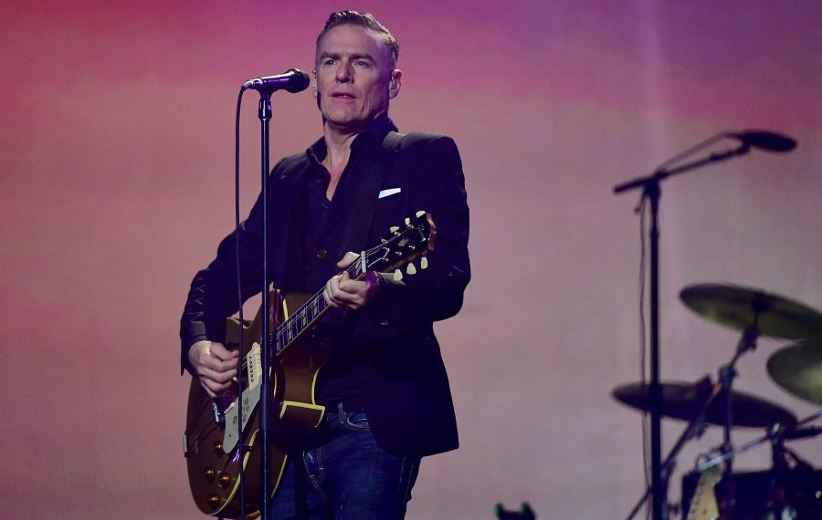 Singer-songwriter Bryan Adams, pictured playing Toronto in 2017, joined Billy Idol on the bill Friday at Darien Lake. (Getty Images)