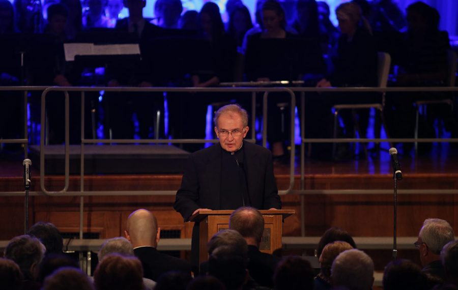 Monsignor Peter Popadick speaks during a 2014 ceremony at the Cleveland-Hill academic complex in Cheektowaga.  (News file photo)