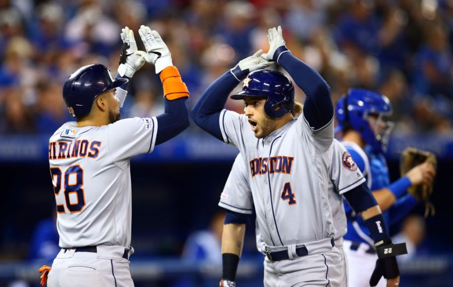 Astros outfielder George Springer, right, celebrates his mammoth three-run homer Friday night in Toronto with Robinson Chirinos (Getty Images).