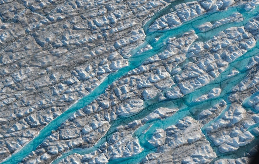 In this view from an airplane rivers of meltwater carve into the Greenland ice sheet near Sermeq Avangnardleq glacier on Aug. 4, 2019 near Ilulissat, Greenland. The Sahara heat wave that recently sent temperatures to record levels in parts of Europe has also reached Greenland. Climate change is having a profound effect in Greenland, where over the last several decades summers have become longer and the rate that glaciers and the Greenland ice cap are retreating has accelerated. (Photo by Sean Gallup/Getty Images)