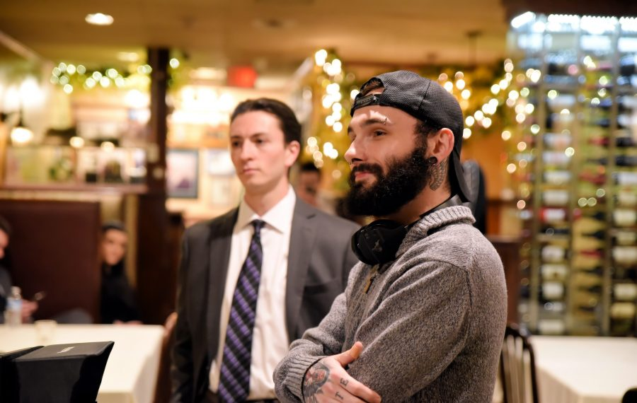 """West Seneca filmmaker Joseph Barone (foreground) directs his close friend and actor Matthew Amoia in a scene from """"The Hired Hitman."""""""