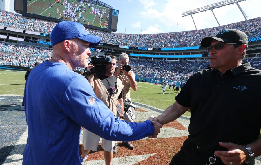 Buffalo Bills coach Sean McDermott shakes the hand of Carolina Panthers head coach Ron Rivera at the end of the game at Bank of America Stadium in Charlotte on Sunday, Sept. 17, 2017. (James P. McCoy/News file photo)