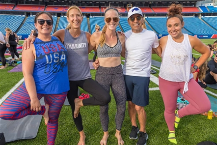 Yoga instructors and more than 500 yogis took part in the fifth annual Namastadium, a giant yoga event on Wednesday, Aug. 21, 2019 at New Era Field, under the lights on the Buffalo Bills' new turf.