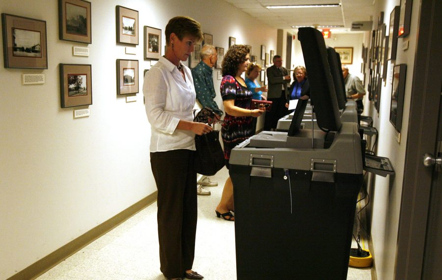 Orchard Park residents vote on a proposal to downsize the Town Board from five to three members on Sept. 23, 2009. (Harry Scull Jr./News file photo)
