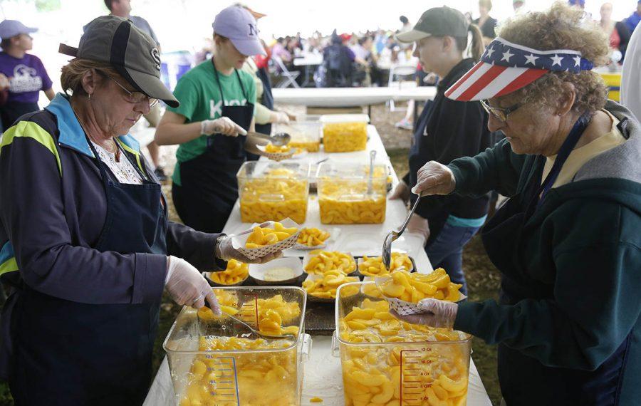 Volunteers dish up peach shortcake at the 2014 festival. (Derek Gee/Buffalo News)