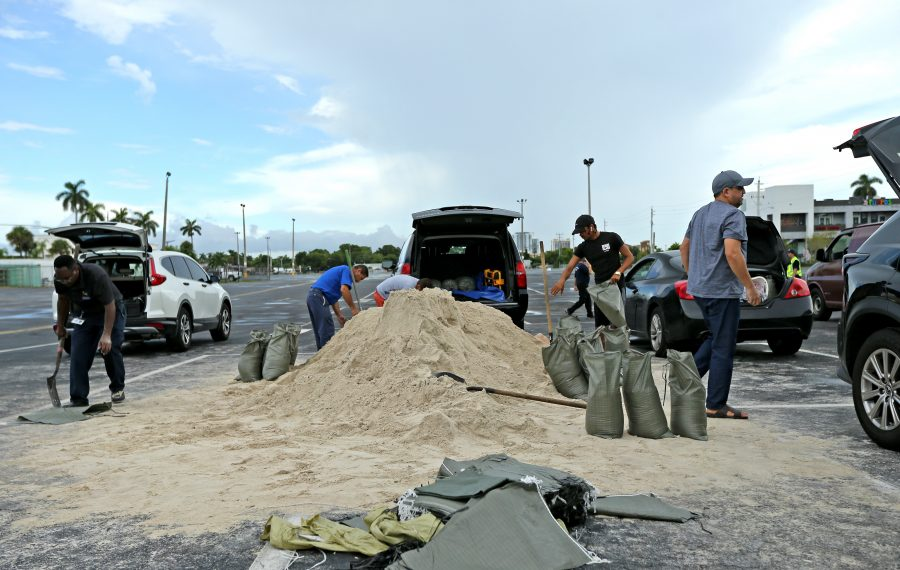 People fill sand bags at the parking of the Big Easy Casino Friday in Halllandale Beach, Fla., as they prepare for Hurricane Dorian. (David Santiago/Miami Herald/TNS)