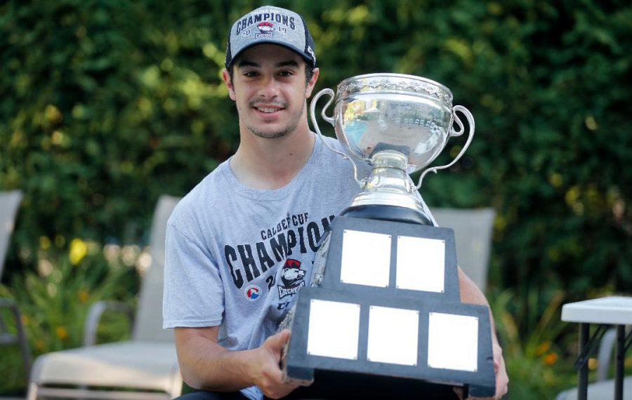 Andrew Poturalski in Snyder Monday with the Calder Cup. Poturalski's Charlotte Checkers won the American Hockey League championship and he was MVP of the league finals. (Mark Mulville/Buffalo News)