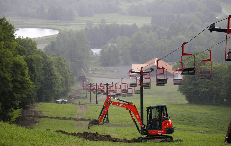 Crews work on the electric lines to the ski lifts at the Cockaigne Resort. The new lodge is visible at the base of the hill. (Mark Mulville/Buffalo News)