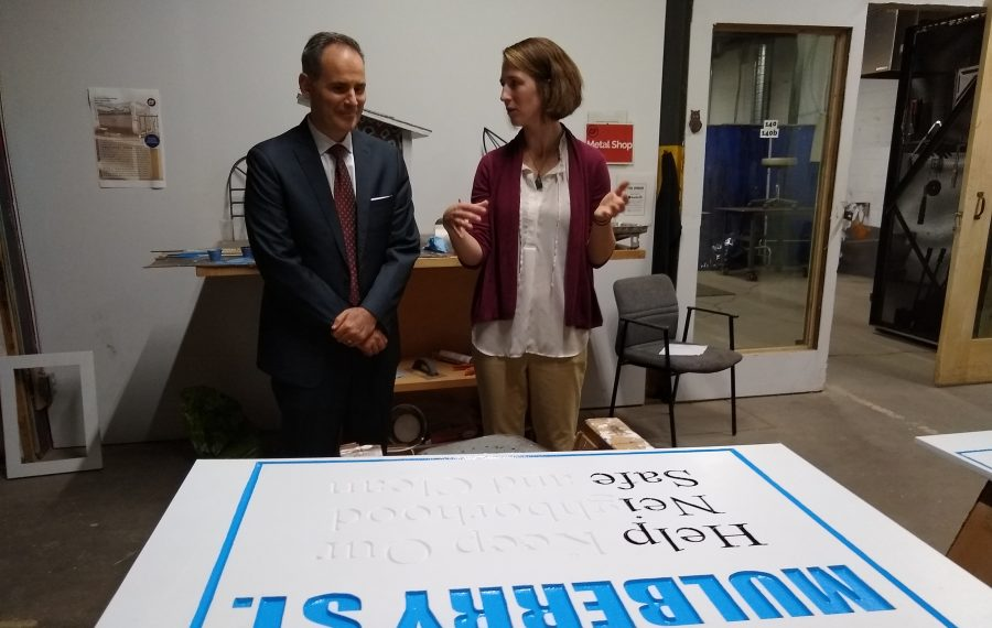 Chris Pilkerton, left, acting administrator of the SBA and Megan McNally, executive director of the Foundry, look over a sign being made at the incubator. (Matt Glynn/Buffalo News)