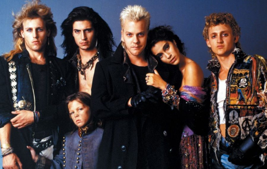 """Kiefer Sutherland, center (being hugged by Jamie Gertz), leads the bloodthirsty teen vampires of """"The Lost Boys."""""""