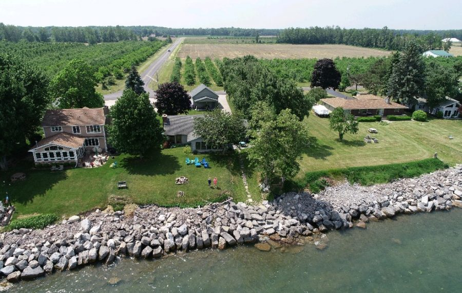 A June 2018 aerial view of the Somerset home of Christine Bronson and Robert Verheyn, who spent $17,000 to build a rock wall along Lake Ontario after losing 25 feet of land to erosion in 2017. (Derek Gee/Buffalo News)