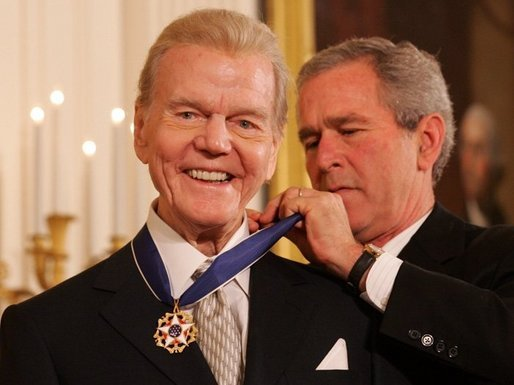 President George W. Bush, right, presents the Presidential Medal of Freedom to Paul Harvey in 2005.. (White House photo by Shealah Craighead)