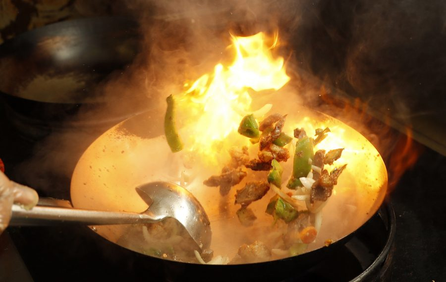 In Tonawanda, Qutoom chef Mohammed Shofiq prepares the lamb sizzler in a wok. (Sharon Cantillon/Buffalo News)