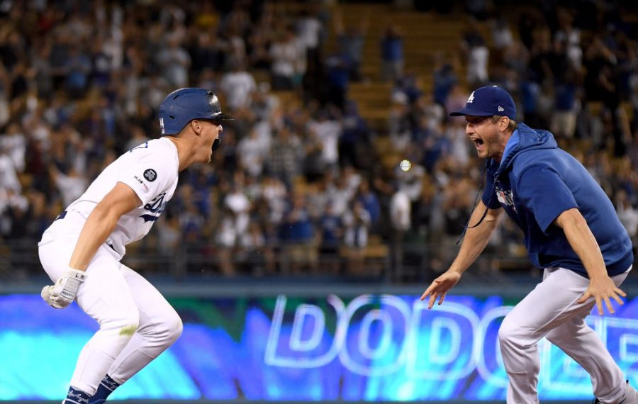 Enrique Hernandez, left,   celebrates with his walkoff single with teammate David Freese after the Dodgers' win over the Blue Jays Thursday night (Getty Images).