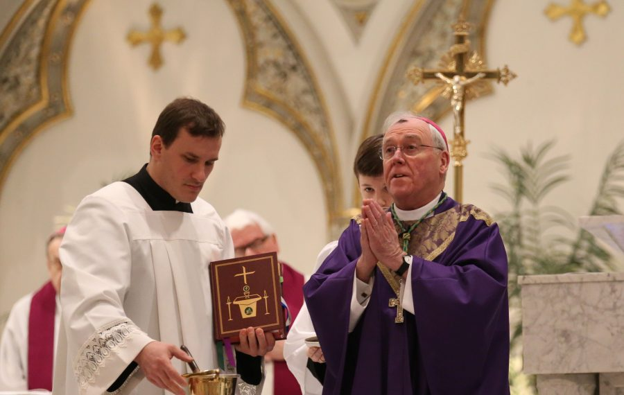The Rev. Ryszard Biernat is by the side of Bishop Richard Malone as Malone celebrates Mass at St. Joseph Cathedral in 2017. (Sharon Cantillon/Buffalo News)