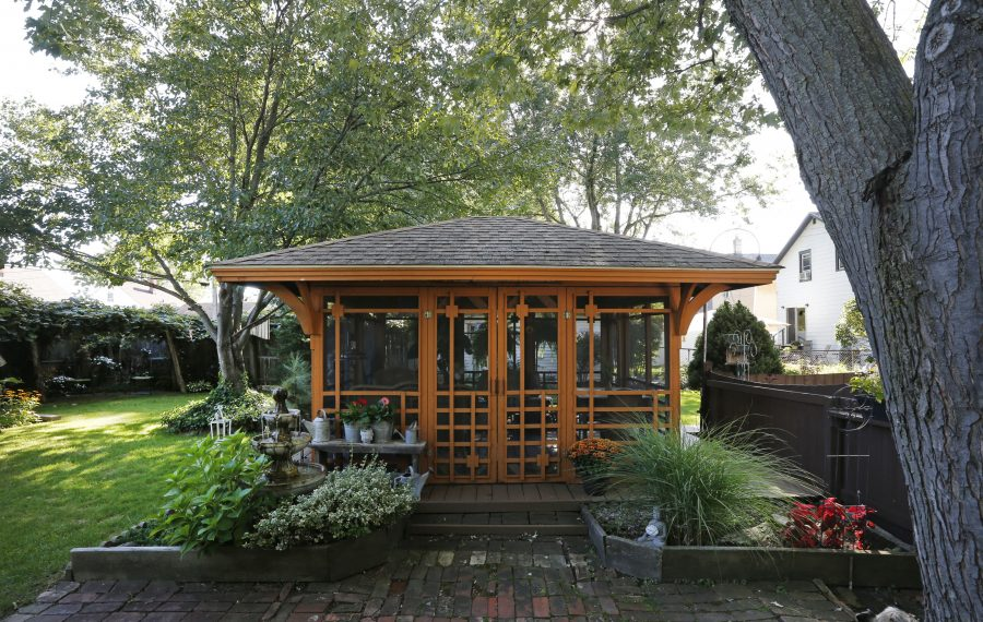 The gazebo in Dean and Jody Wienke's backyard in the City of Tonawanda was designed and built by Dean and has evolved through the years.  (Robert Kirkham/Buffalo News)