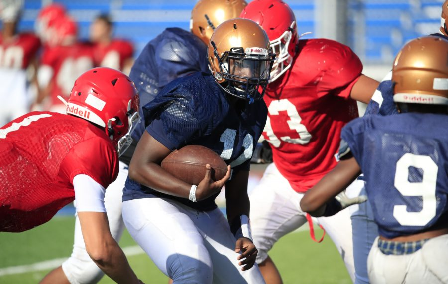Sweet Home quarterback Jamel Lucas runs against Williamsville East during a scrimmage. (Harry Scull Jr./Buffalo News)