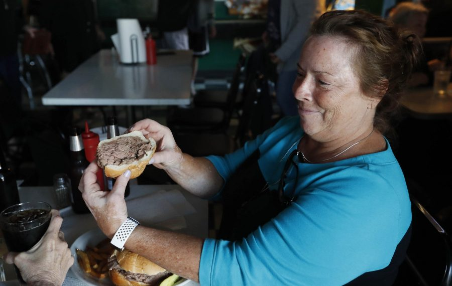 Kim Volker of the Town of Tonawanda shows off the amount of roast beef in her beef on weck. (Sharon Cantillon/Buffalo News)