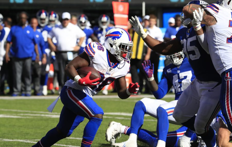 Buffalo Bills running back Devin Singletary runs against the New York Giants during the fourth quarter Sunday at MetLife Stadium. (Harry Scull Jr./Buffalo News)