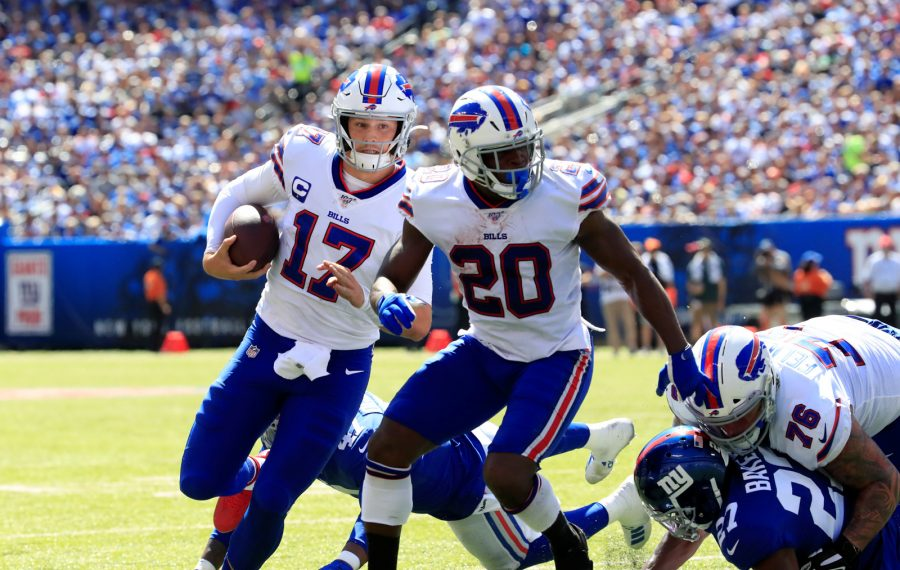 Buffalo Bills quarterback Josh Allen runs for a touchdown against the New York Giants during the first quarter Sunday at MetLife Stadium. (Harry Scull Jr./Buffalo News)