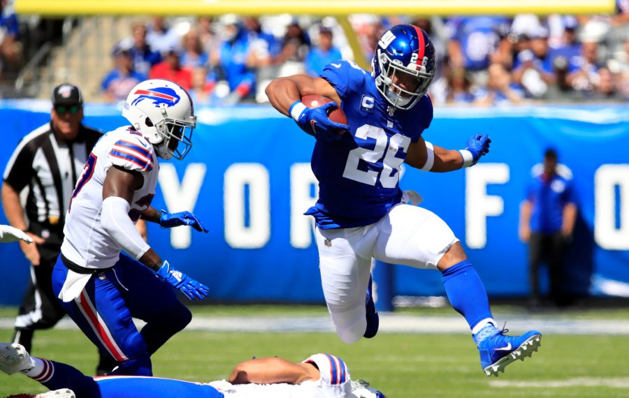 Saquon Barkley found running room early, but the Buffalo Bills' defense corrected things after a poor opening drive in what was a 28-14 victory Sunday. (Harry Scull Jr./Buffalo News)