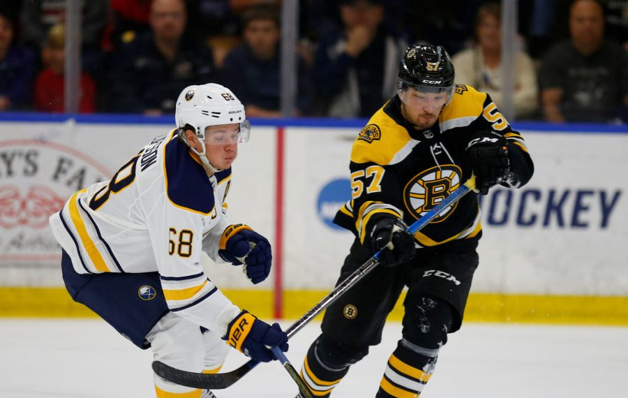 Buffalo Sabres forward Victor Olofsson chases a loose puck with Boston Bruins Robert Lantosi during the first period of prospects Prospects Challenge at Harborcenter on Saturday, Sept. 7, 2019. (Harry Scull Jr./Buffalo News)