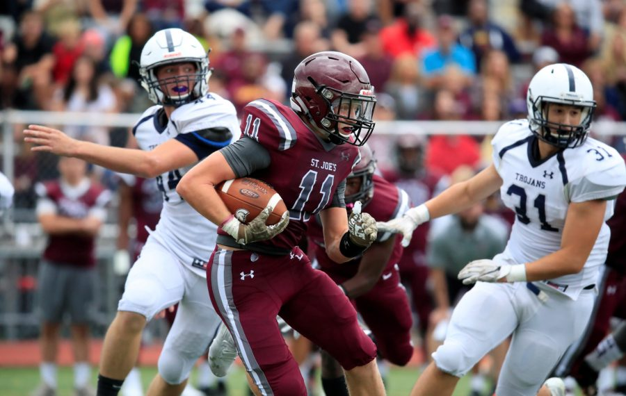 St. Joe's receiver Sam Kline runs after a catch against McDowell during first half action at St. Joe's Saturday (Harry Scull Jr./Buffalo News)