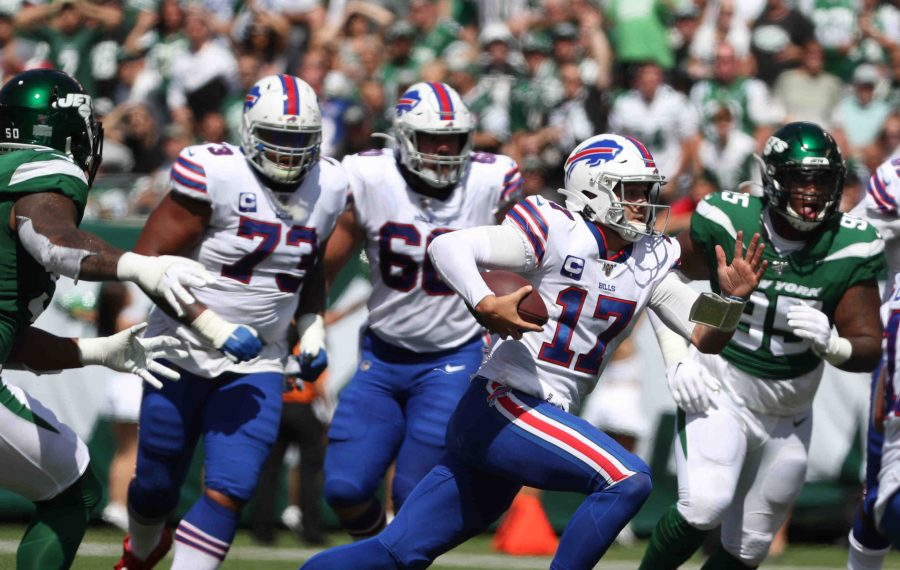 Bills quarterback Josh Allen rushes for a first down past New York Jets strong safety Jamal Adams. (James P. McCoy/Buffalo News)
