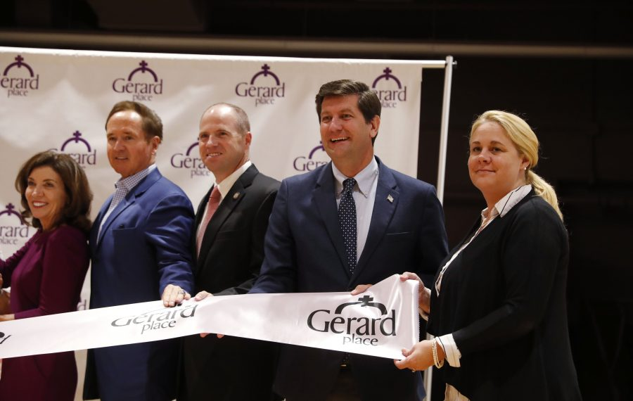 Erie County Executive Mark Poloncarz, second from right, cuts the ribbon at the opening of Gerard Place Community Center, along with Lt. Gov. Kathy Hochul, Rep. Brian Higgins and State Sen. Tim Kennedy. It's just one of the perks of incumbency Poloncarz enjoys as he runs for re-election. (Sharon Cantillon/Buffalo News)