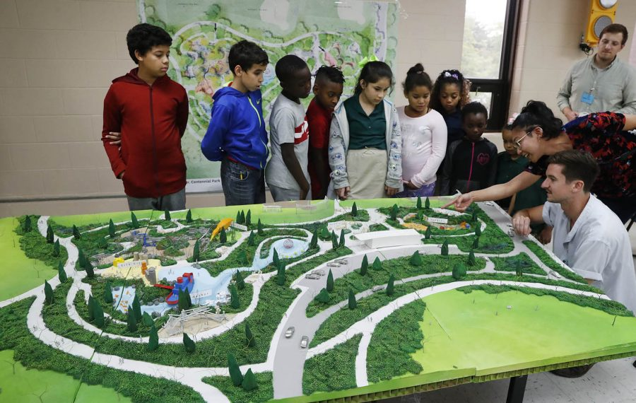 Children in an after-school program at the Belle Center on the West Side looked at a diorama of a playground being developed for a redesigned LaSalle Park by landscape architectural firm Michael Van Valkenburgh Associates of Brooklyn, on Sept. 12. They were given a chance to offer feedback on what they saw. (Sharon Cantillon/Buffalo News)