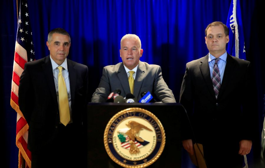 U.S. Attorney James P. Kennedy, center, along with Assistant U.S. Attorney Michael DiGiacomo, left, and Gary Loeffert, Special Agent-in-Charge of the FBI Buffalo office, announce the arrest of Peter Hingston, a teacher at City Honorsr. The arrest was prompted by four students who spoke up about Hingston's conduct. (Harry Scull Jr./Buffalo News)