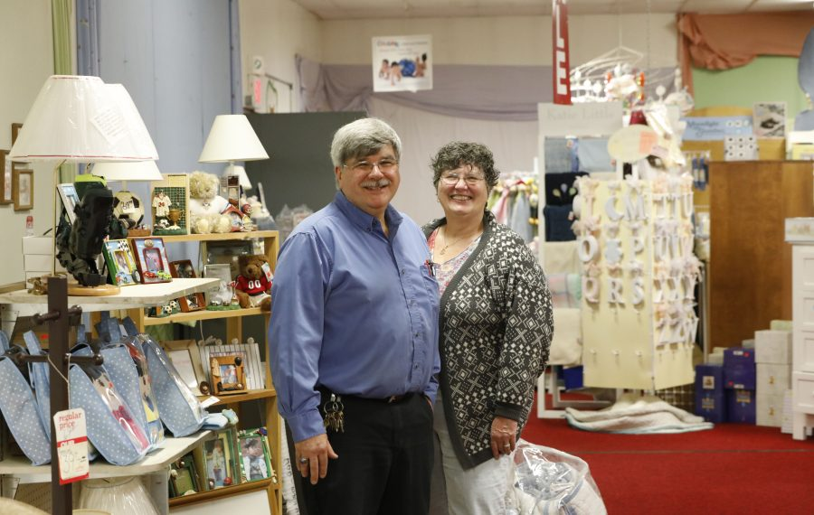 Siblings Sharon and Gary White stand amid the items left they are selling at a steep discount before they retire. (Derek Gee/Buffalo News)