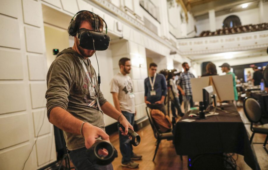 Daemen College student Jacob Thompson plays a virtual reality game called Apocalyptic Adventure designed by Paul Peccia of Buffalo, center, during the Buffalo Game Expo which kicks off the Techstars Startup Week Buffalo on Sunday, Sept. 15, 2019. (Derek Gee/Buffalo News)
