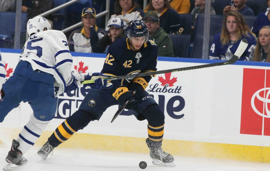 Dylan Cozens battles Toronto center Nick Shore for the puck during the Sabres' preseason game against Toronto on Sept. 21 in KeyBank Center. (James P. McCoy/Buffalo News)