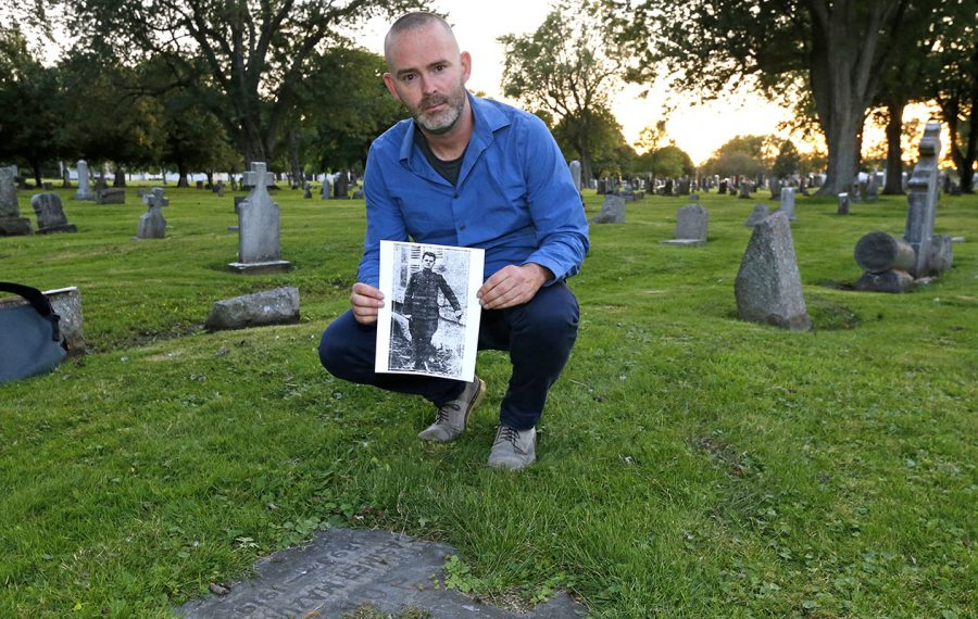 Chris Hawley, a student of local history, researched and discovered the grave of Casimer Mazurek, a laborer and veteran who was shot to death in a crowd during labor unrest a century ago. (Robert Kirkham/Buffalo News)