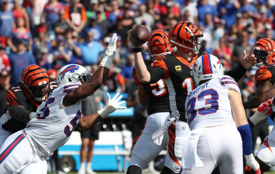 Bills outside linebacker Lorenzo Alexander (57) puts head on quarterback Andy Dalton. (James P. McCoy/Buffalo News)